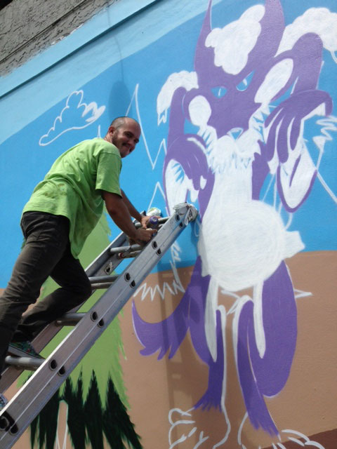 Christopher working on Clematis Street Mural