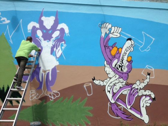 Christopher at work on the new mural