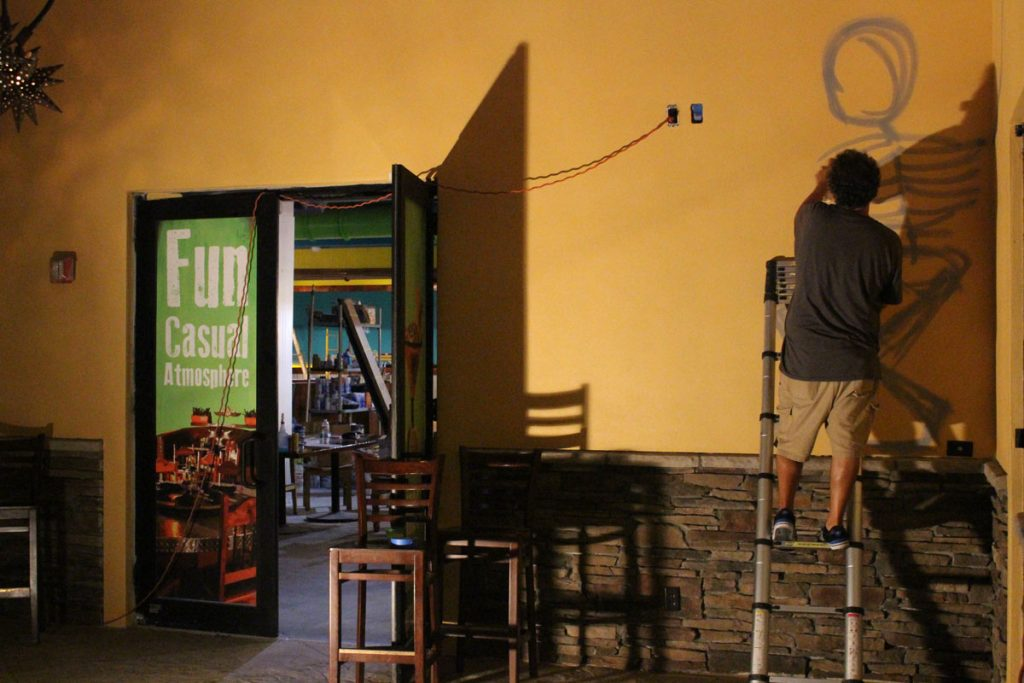 CANVAS-participating artist painting the walls of the soon-to-open Cabo Flats Restaurant
