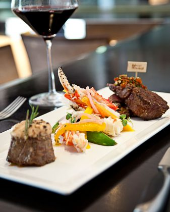 Meat Palm Beach Mixed Grill featuring Steamed Crab Leg Prime deckel and Petit Filet | Photo: Michael Pisarri