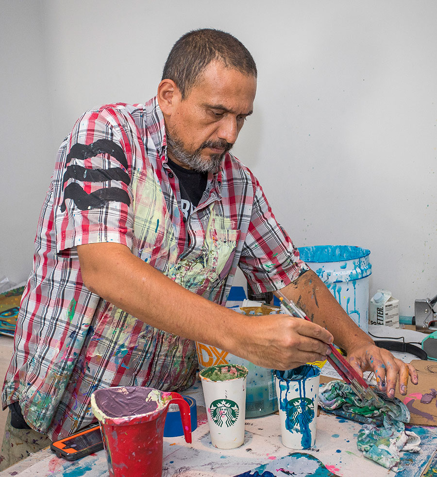 Artist Renzo Ortega paints the immigrant experience
