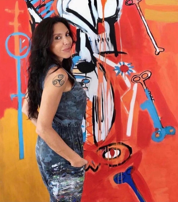 Artist Fernanda Lavera with her work.